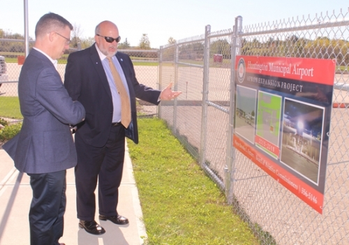 Mayor Brooks Fetters (right) fills in U.S. Representative Jim Banks about the Huntington Municipal Airport's apron expansion project during a stop at the facility on Tuesday, Oct. 17. Banks spent the day in Huntington as part of a weeklong tour of the Third Congressional District.
