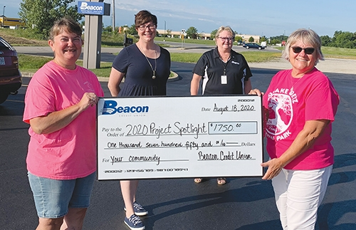 Featured are winners of Beacon Credit Union's 10th annual Project Spotlight program. Representatives from winning programs are (from left) Dawn Stanley, of Helping Paws, Erin Didion, of Love In the Name of Christ, Beacon representative Cheryl McCoy, and Jean Pasko, of Drake Goetz Memorial Park. The program received 68 nominations and over 64,000 votes over a one-month voting period.