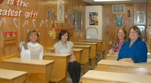 "Instructors for the ""By the Book"" program, shown in one of the program's mobile classrooms, are (from left) Katie Mower, Mary Clark, Debbie Hersey and Director Teri Shiflett."