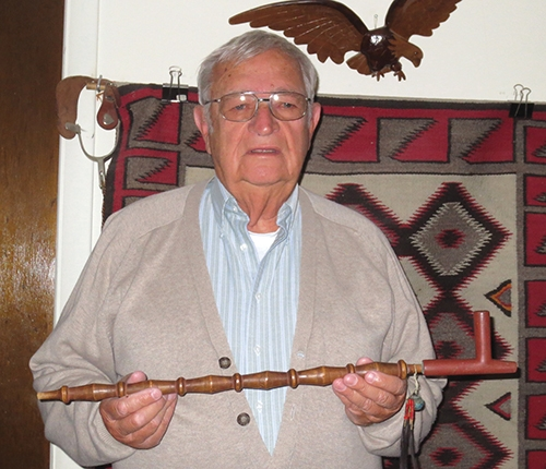 "Jim Bickel of Huntington holds the ""peace pipe"" that was used at the 100th birthday celebration of Miami Indian woman Kil-so-quah. The event was held in Roanoke on July 10, 1905. Bickel will present a program on Native American artifacts on Wednesday, July 17, at the Huntington County Historical Museum at 7 p.m."