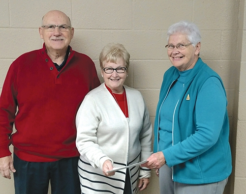 Dave and Sue Stamper (left and center) of Union Church recently present Nancy Beaver, president of the Associated Churches of Huntington County, with a check for $10,000. The donation was raised during a fish fry event held Nov. 1.