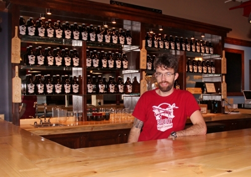Ben Thompson, the owner-brewer of Birdboy Brewing, stands behind the bar at Birdboy Brewing Taproom, in Roanoke. The brewpub, located at 314 N. Main St., will serve Birdboy Brewing beer and food from the Joseph Decuis Farm. It has a soft-opening event scheduled for today, Thursday, Dec. 28, at 7 p.m. that is open to the public.