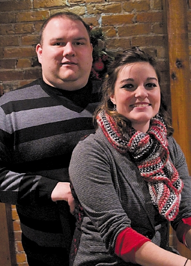 "Andrew Sprinkle (left) recently became the sole owner of Brick House Grill, in Huntington. His wife, Barbra, is ""front of the house"" manager."