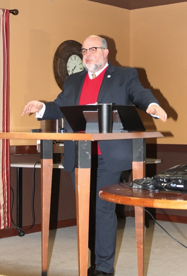 Huntington Mayor Brooks Fetters emphasizes a point during his State of the City report, presented Friday, Feb. 1, at Café of Hope. Among the city's future plans is a new police station and a 127-acre industrial park.
