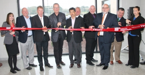 Continental Structural Plastics personnel, local government officials and economic development dignitaries cut the ribbon at a new 130,000 square-foot facility on the CSP Huntington campus on Friday, Oct. 26. Celebrating the occasion are (from left) Linda Walczak, director, Northeast Region, Indiana Economic Development Corporation; Larry Buzzard, president, Huntington County Board of Commissioners; Steve Rooney, CEO, Continental Structural Plastics; Dave Malik, director, Lower Body Structures, General Motors; Masumi Hirata, assistant to Composites Business Unit Manager; Rob Miller, Huntington County commissioner; Mark Voss, engineering group manager, General Motors; Huntington Mayor Brooks Fetters; Mark Wickersham, executive director, Huntington County Economic Development; and Karen Williams, plant manager, CSP Huntington.