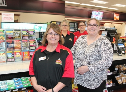 Huntington resident Dawn Eppard (front left) is the store manager of the new Casey's General Store, located at 1374 Flaxmill Rd., Huntington. She is joined by (front row, right) Casey's Area Supervisor Michelle Cottingham, and (back row from left) store clerks Denise Tun and Christina Stephan.
