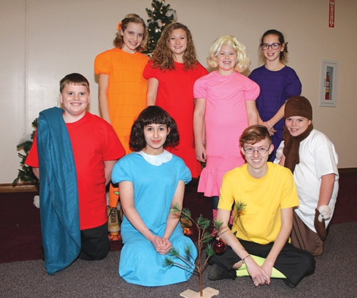 "Cast members of the Huntington Theatre Guild: Act II production of ""A Charlie Brown Christmas"" take a break from rehearsal on Wednesday, Nov. 29. Pictured (front row, from left) are Wallace Rowley, playing Linus; Mia Cotton, playing Lucy; Bryce Foerman, playing Charlie Brown; and Craig Rowley, playing Pigpen; and (back row, from left) Solveig Webb, playing Patty; Sophia Tolen, playing Frieda; Emily Albertson, playing Sally; and Evie Webb, playing Violet."