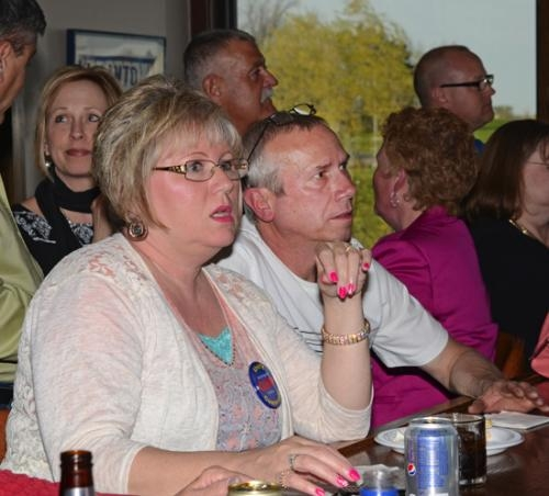 Huntington County Recorder Cheryl Schenkel (left) and her husband Roger pay close attention to a monitor displaying Huntington County Republican primary election results at a Republican gathering at the Knights of Columbus Hall on Tuesday, May 6.