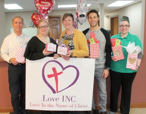 "Huntington Chiropractic Clinic's annual ""Spread the Love"" for Love INC fund-raiser will be held Wednesday, Feb. 14. Celebrating the occasion are (from left) chiropractor and owner, Dr. Stephen Geders; Love INC Food Pantry Coordinator Kelley Miller; Love INC Ministry Coordinator Erin Didion; Austen Dettling of Pizza Junction; and Chiropractic Assistant Alysha Storie."