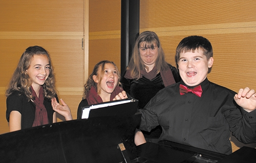 Members of the Children's Choir of Huntington County (from left) Claire Troyer, Sophia Tolen, Emma Shenefield and Jay Clampitt prepare for the CCHC fall concert on Nov. 4 at 7 p.m. at St. Peter Lutheran Church.