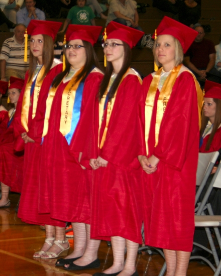 The Huntington North High School Class of 2013 officers (from left) Lauren Daas, treasurer; Paige Applegate, secretary; Sierra Dinius, vice president; and Morgan Flora, president; stand for recognition during the school's Achievement Night, Monday, May 13