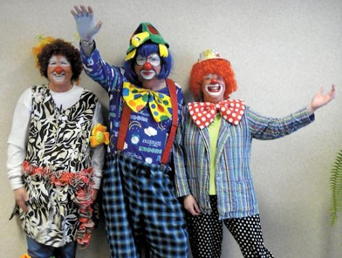"Joy Pleasers Clown Ministry held its graduation and commissioning ceremony on April 23. New clowns are (from left) ""Flower"" (Susan Miller), ""Turtle King"" (Mark Bickel) and ""Crazy Legs"" (Debbie Abbott)."