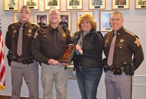 On Friday, Feb. 8, Sgt. Steve Coe and his wife Patti (center) were recognized for going above and beyond the call of duty.