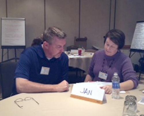Jan Baumgartner (right), director of Pathfinder Community Connections, participates in a recent conference sponsored by NeighborWorks America.