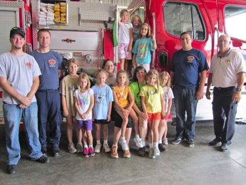 Girl Scout Daisies and Brownies from Huntington Catholic School Troop 20299 celebrate their successful cookie sales by visiting the Jefferson Township Volunteer Fire Department to tour the facility and meet with firefighters.