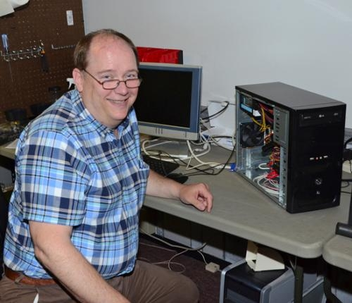 Robert Coolman, owner of Coolman's Computer Service, in Warren, works on a repair in his recently-opened shop at 223 N. Wayne St., next to D&D Bikes.