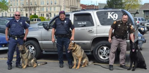 The three police dogs working in Huntington County, shown here with their handlers, will be the beneficiaries of a fish and tenderloin dinner on Wednesday, May 15, from 4:30 to 7:30 p.m. at the PAL Club in Huntington.