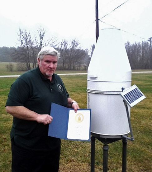 Larry Covey was recognized by the northern Indiana office of the National Weather Service for serving as a volunteer weather observer for 15 years.
