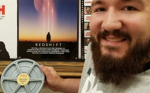 "Huntington University student Ben Crane, who was one of the Broadcast Education Association Festival's first-place award recipients, holds the award presented for the film ""Redshift."""