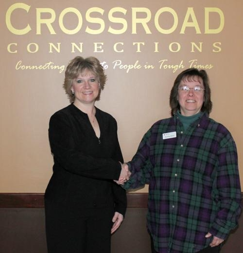 Valerie Fields (left), director of Crossroad Connections, in Huntington, stands with Vickie Ellis, program specialist for the Huntington County Chapter of the American Red Cross.