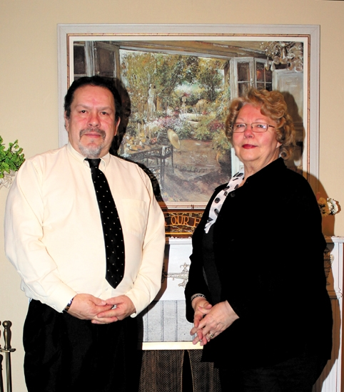 Dan (left) and Rita Gallegos, owners of D & R Wallcovering, in Huntington, are celebrating 25 years of business.