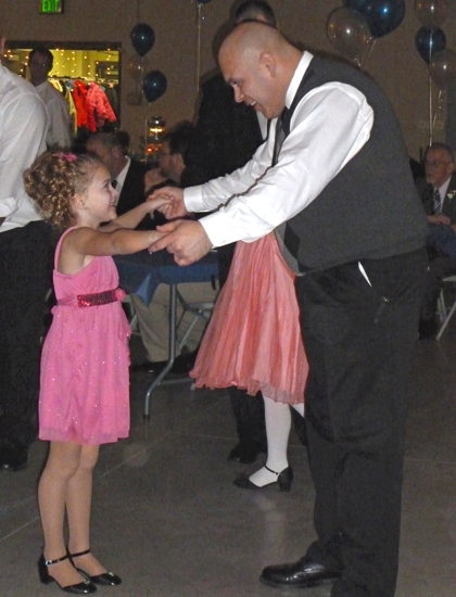 Macey Long (left) shares a dance with her dad, Chris Long (right), during last year's Daddy-Daughter Dance. The Huntington Parks and Recreation Department will bring the dance back again this year, with sessions on Feb. 22 and Feb. 23.