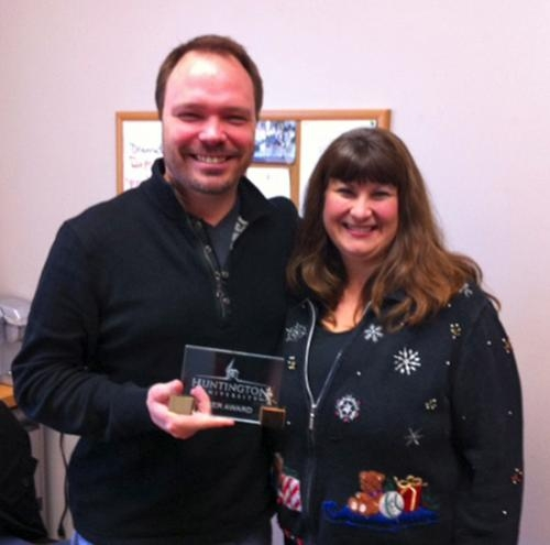 Joe Duffer (left) was recognized by Joni Killian with one of two Huntington University Peer Awards for the month of December.