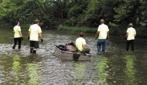 "Some of the 87 volunteers that helped clean the Wabash River during the ""De-Trash the Wabash"" event on Saturday, July 27, look for trash to remove.  The whole group removed a total of 8,260 pounds of trash from the river and the riverbanks."