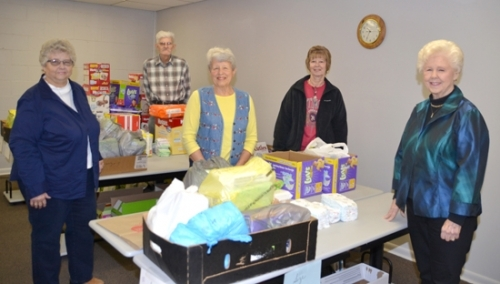 Volunteers with the Bare Necessities diaper ministry show off their new location in a lower level room at the St. Peter Lutheran Church educational building. Volunteers are (from left) Pam Wertenberger, Allen Couch, Marjorie Richardson, Janet Bennett and Barba Eickhoff.