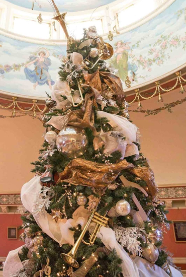 The musically inspired Christmas tree in the Brookside Ballroom on the campus of the University of Saint Francis that was decorated by Designs by Dinius, of Huntington, took home the People's Choice award during the university's Christmas in the Castle celebration this month.