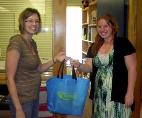 Lisa Pape (left) presents a gift to Direct Support Professional Rachel Hamm in honor of Pathfinder's direct support professional week.