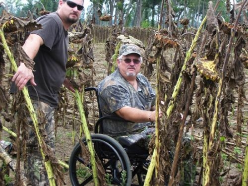 Rick Keirn (right), a disabled veteran of the United States Air Force, and his son Kreig Kern (left), who served as guide, participate in the second annual dove hunt for disabled veterans on Sept. 1.