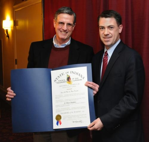 Huntington University President Dr. G. Blair Dowden accepts one of the state of Indiana's highest awards, the Sagamore of the Wabash, from State Sen. Jim Banks on Friday, Jan. 25, during a luncheon with the university's board of trustees.