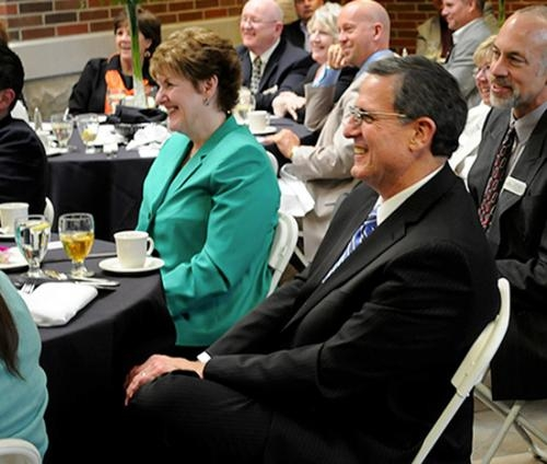 Huntington University President G. Blair Dowden, who plans to retire on May 31, and his wife Chris Dowden listen as university officials announce the naming of the Dowden Science Hall on the HU campus in their honor.