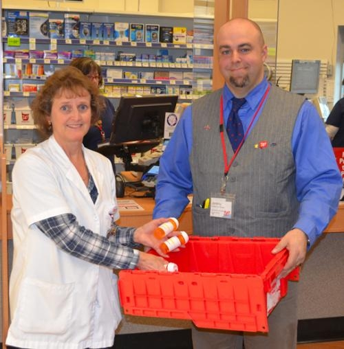 Huntington Walgreens Pharmacy Manager Robin Baker (left) and Jeremy Penrod, store manager, say the store will be collecting unused or expired medication for safe disposal on Friday, April 26, from 9 a.m. to 1 p.m.