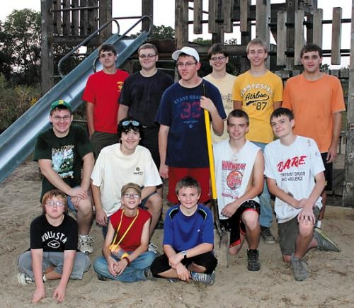 Anthony Schmaltz (second row, third from left) of Boy Scout Troop 637, in Huntington, stands with his fellow scouts before a playset on the Police Athletic League grounds, in Huntington, on Tuesday, Sept. 10.