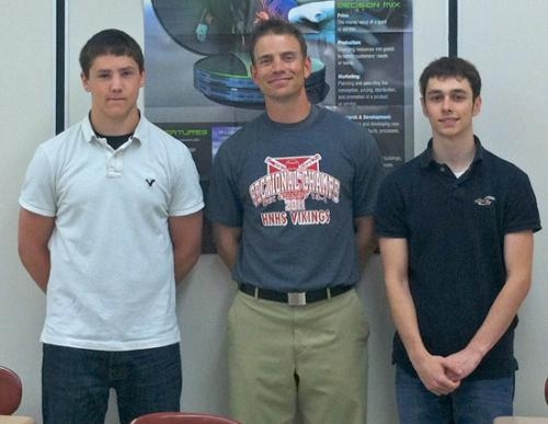 """Huntington North High School students Taylor Boxell (left) and Jason Ervin (right) qualified for the national Junior Achievement tournament, """"J.A. Titan."""" With them is Kyle F. Daugherty (center), economics teacher at HNHS."""
