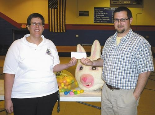 Brock Tucker of the Huntington Jaycees (right) donates eggs, an Easter Bunny costume and $300 to the Huntington Salvation Army for the Community Easter Egg Hunt in Huntington. The donation is received by Captain Barbara McCauley of the Salvation Army.