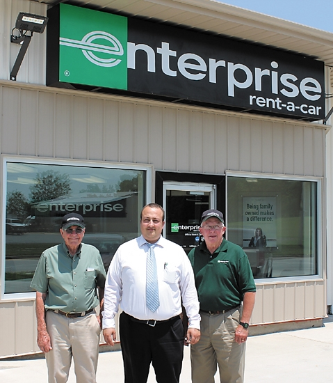 Andrew Ley (center), management assistant at Enterprise Rent-A-Car, in Huntington, stands outside the business's new location at 1012 E. Tipton St. with service agents Tom Smith (left) and Vern Neel.