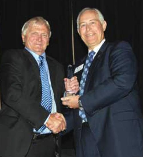 Rep. Jeff Espich (left) receives the Indiana Bankers Association 2012 Legislator of the Year award from the association's president and chief executive officer, S. Joe DeHaven (right).