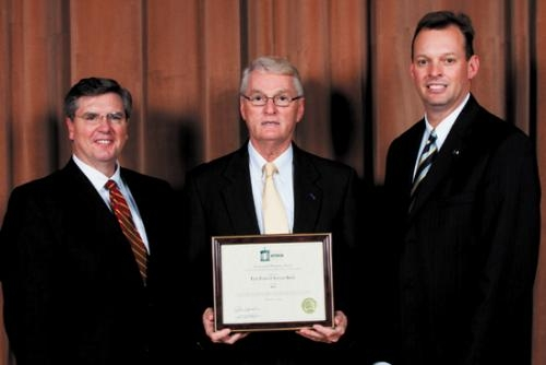 Daniel Hasler (left), Indiana Secretary of Commerce, presented Stephen Zahn (center), First Federal Savings Bank chairman of the board, and Michael Zahn (right), First Federal Savings Bank president and CEO, with the Centennial Business Award Dec. 3.