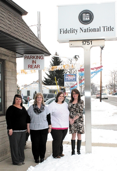 The former Lawyers Title Insurance office has changed its name to Fidelity National Title. Pictures are the staff of the Huntington office, located at 1751 N. Jefferson St.