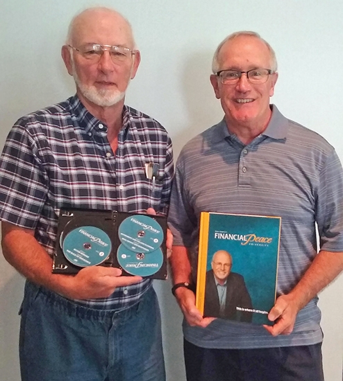 Richard Hinton (left) and Rev. Rusty Strickler are shown with materials used to teach the Financial Peace class starting Sunday, Sept. 17, from 8 a.m. to 9:45 a.m. and Wednesday, Sept. 20, at Warren First Baptist Church.