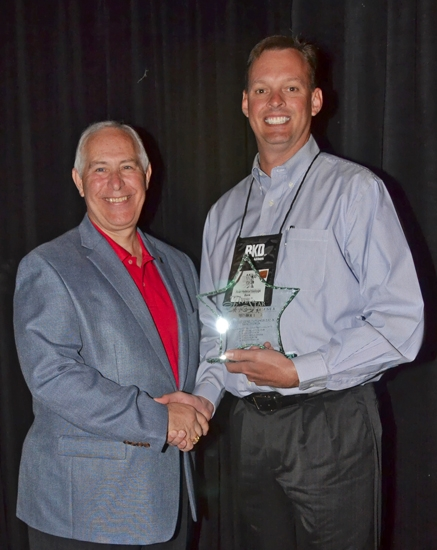 Michael Zahn (right), president and CEO of First Federal Savings Bank, in Huntington, accepts a Five Star Award on behalf of the bank from Indiana Bankers Association President and CEO Joe DeHaven on Tuesday, May 14, at the IBA's Mega Conference.