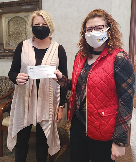 "First Federal Savings Bank held a ""Swipe-to-Win"" contest from Nov. 23, 2020, to Dec. 31, 2020. Featured, business card winner Ashlie Buzzard of Hoosier Real Estate Group accepts her check from Marketing Assistant, Sydni Fife, at the Frontage Road bank location in Huntington."