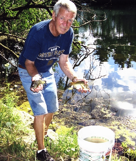 Dan Bickel, organizer of the Police Athletic League Fishing Derby, stocks the PAL pond with fish. The derby will be held on Sunday, Oct. 21 at the PAL pond, located on the PAL grounds at 2099 Riverside Drive, in Huntington.