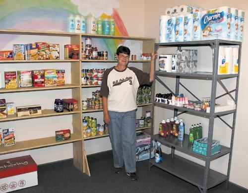 Jo Brown stands in the new food pantry at Gethsemane Ministries, in Huntington, on Monday, July 1. Though Brown headed up the project, she credits the entire church for making it a reality.