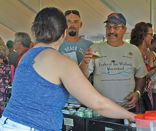 Huntington Area Recreational Trails Association President Jim Lewis (right) enjoys a glass of wine at a previous Forks of the Wabash Uncorked. This year's fund-raiser will be held Friday, July 13, from 5:30 p.m. to 9 p.m. at the Historic Forks of the Wabash.