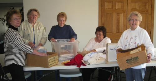 Historic Forks of the Wabash volunteers (from left) Carol Winterholter, Mary Brooks, Alice Sell, Janice Bolin and Phyllis Pieper sort items for last year's fund-raising garage sale at the Historic Forks of the Wabash.