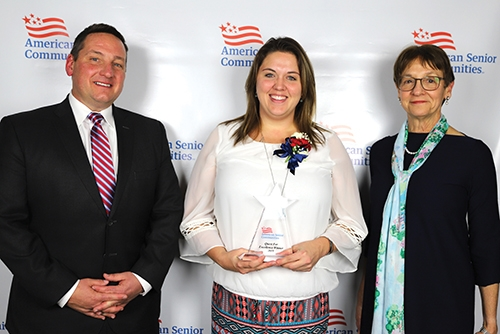 Brittany Foster (middle), a unit manager at Markle Health & Rehabilitation, in Markle, was recognized for providing outstanding service to patients and residents at American Senior Communities' Quest for Excellence Awards Banquet, held recently in Indianapolis. With Foster are ASC Chief Operating Officer David Stordy (left) and ASC Chief Executive Officer Donna Kelsey.